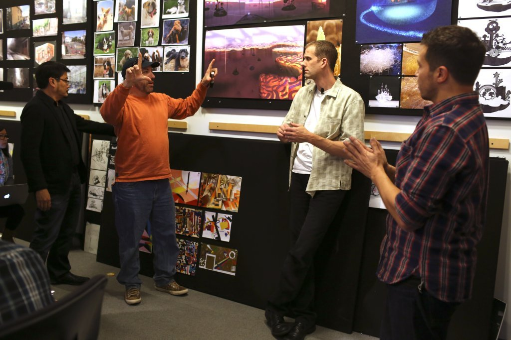 Ronnie Del Carmen, Ralph Eggleston, Pete Docter and Albert Lozano during an Inside Out art review on January 7, 2014 at Pixar Animation Studios in Emeryville, Calif. (Photo by Deborah Coleman / Pixar)