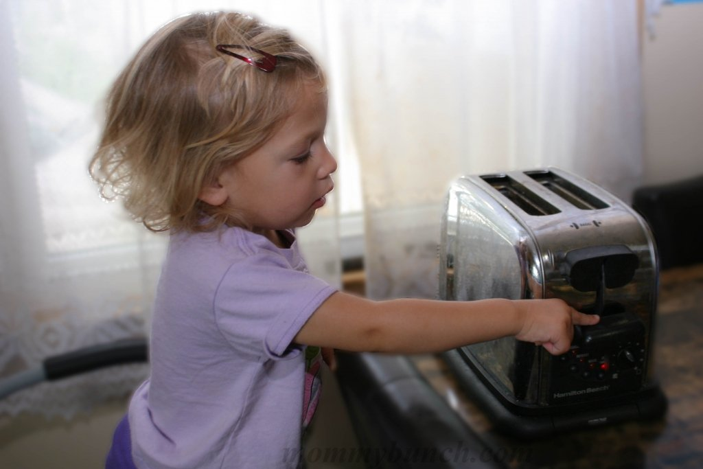 child helping toast