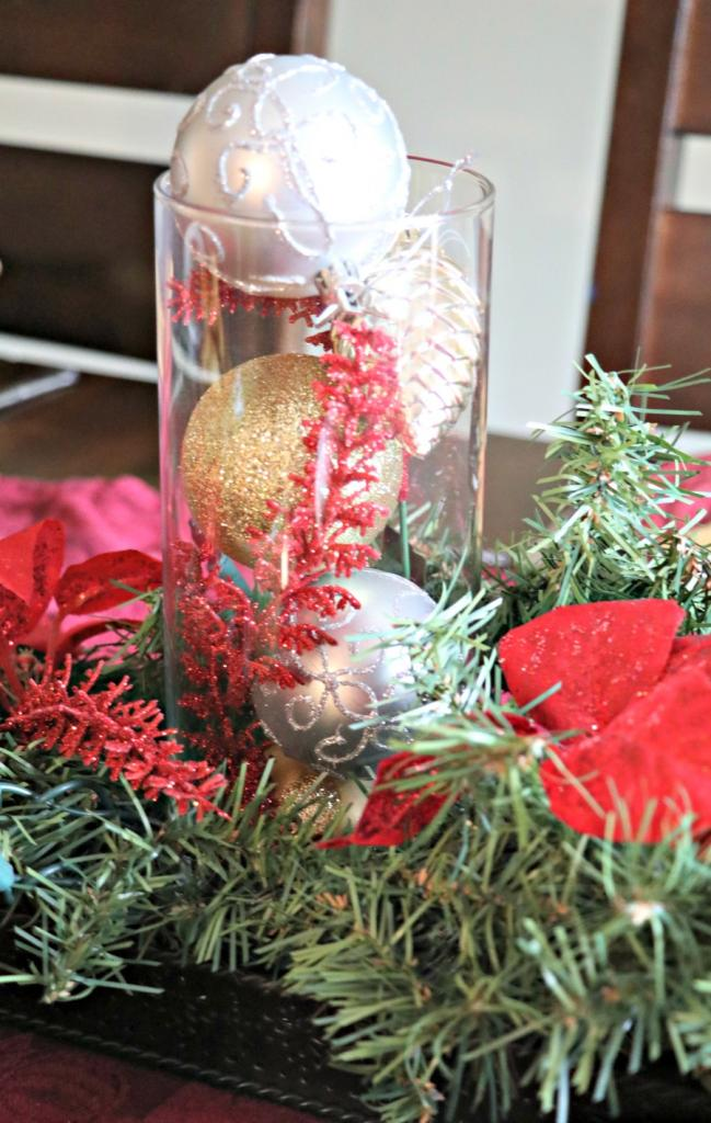 If you love decorating for the holidays but don't have a huge budget, try this simple tip to make cheap Christmas decorations. You can easily and inexpensively create beautiful centerpieces, wreaths, and more simply by doing a little DIY. This Christmas Centerpiece was easy to make and cost less than $10!