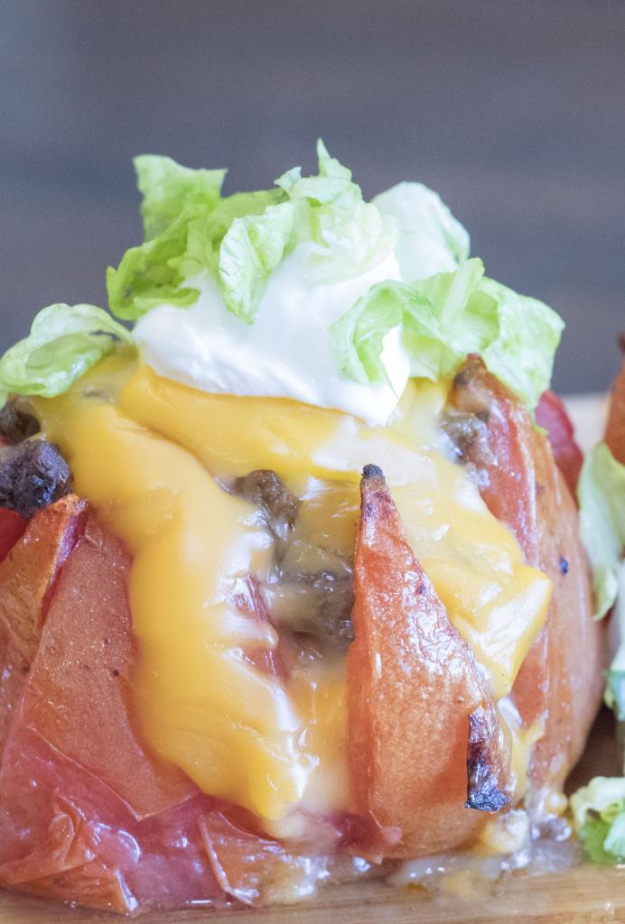 Do you love the flavor of tacos? Do you love adding toppings like tomatoes, cheese, lettuce, sour cream and more? Then you are going to LOVE these cheesy stuffed tomatoes that are basically inside-out tacos! Made with creamy Ricos Premium Cheddar Cheese, they are so easy, so cheesy, and so delicious! #RicosCheesePlease AD @RicosProducts @Walmart